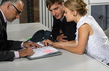 Young Couple Meeting with Businessman